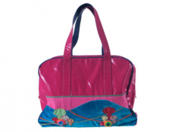 Pink travel bag with mushroom applications by RICE